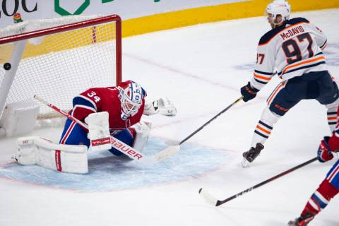 Edmonton Oilers' Connor McDavid (97) scores the winning goal on Montreal Canadiens goaltender J ...