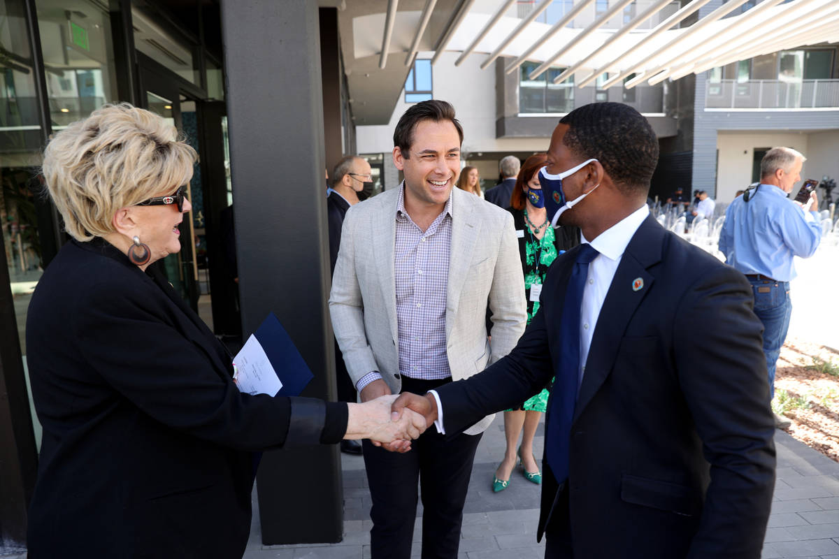 Patrick Brennan, development manager for Aspen Heights Partners, mingles with Las Vegas Mayor C ...