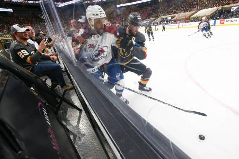 Colorado Avalanche's Pierre-Edouard Bellemare (41) and Golden Knights' Alex Pietrangelo (7) bat ...