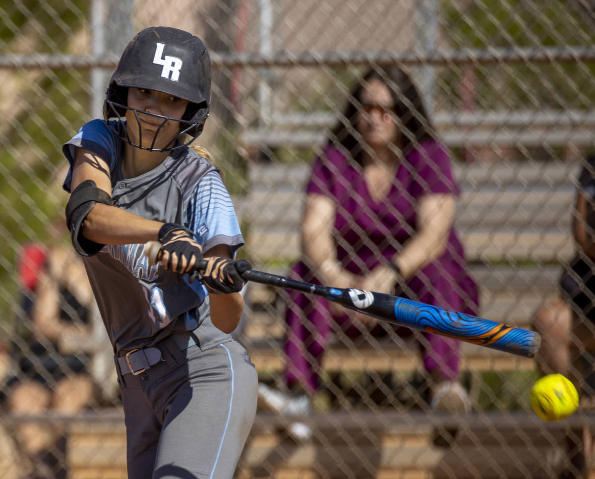 Centennial batter Ellie Bostedt (1) connects with a Faith Lutheran pitch during their NIAA girl ...