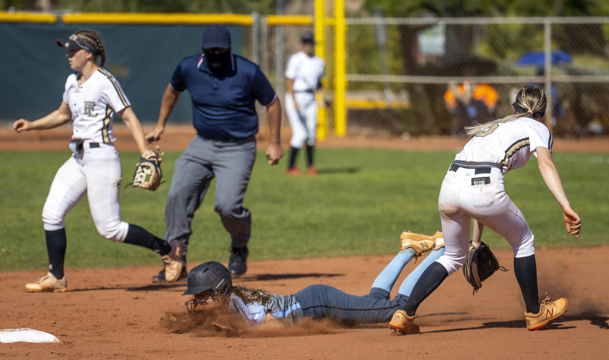 Centennial runner Madison Lucero (6) slides early to second base below a hit to the outfield as ...