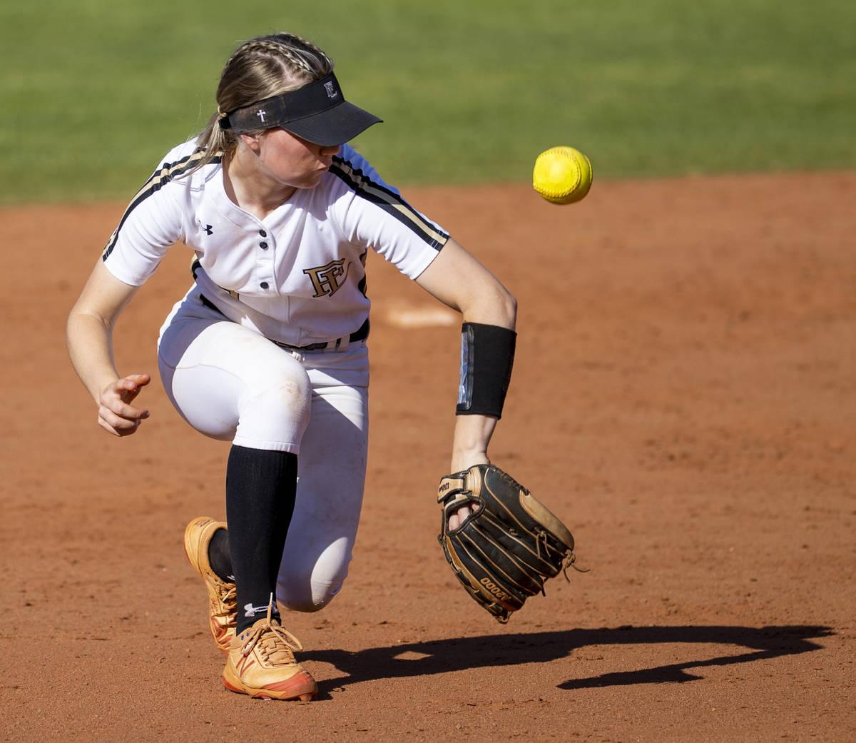 Faith Lutheran short stop Savannah Moore (5) loses a ground ball versus Centennial during their ...