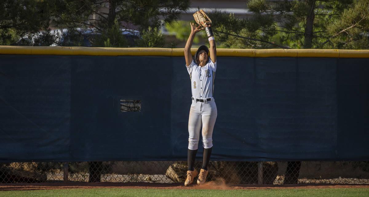 Faith Lutheran outfielder Ava Walker (2) extends up to grab a long fly ball against Centennial ...