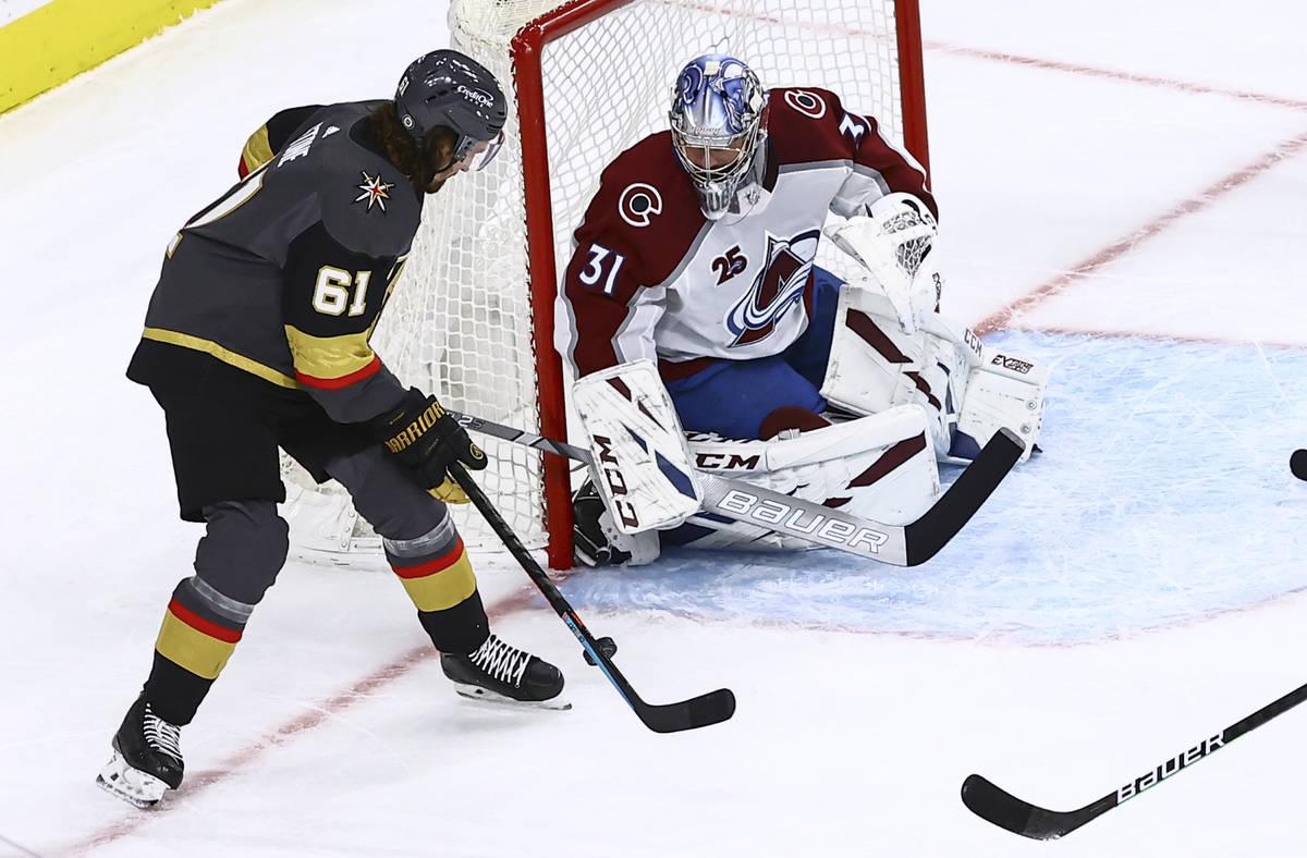 Golden Knights' Mark Stone (61) attempts a shot against Colorado Avalanche goaltender Philipp G ...