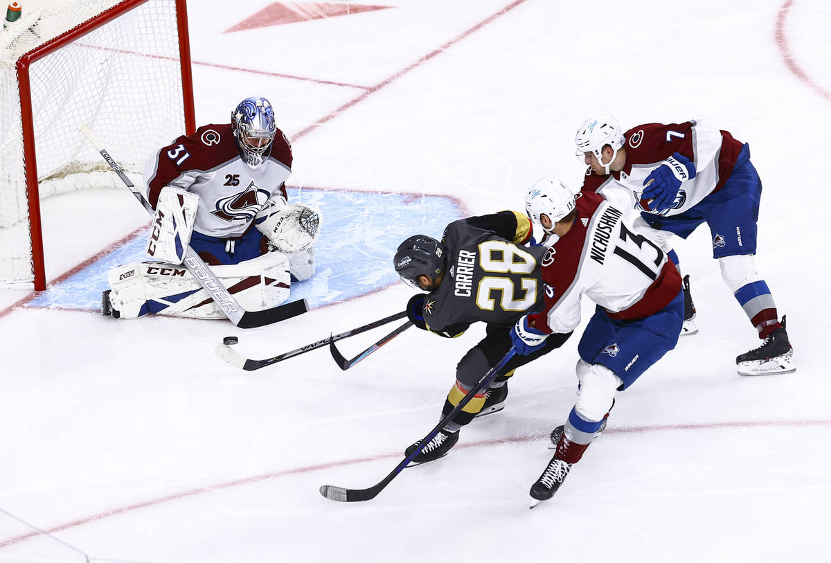 Colorado Avalanche goaltender Philipp Grubauer (31) makes a save against Golden Knights' Willia ...