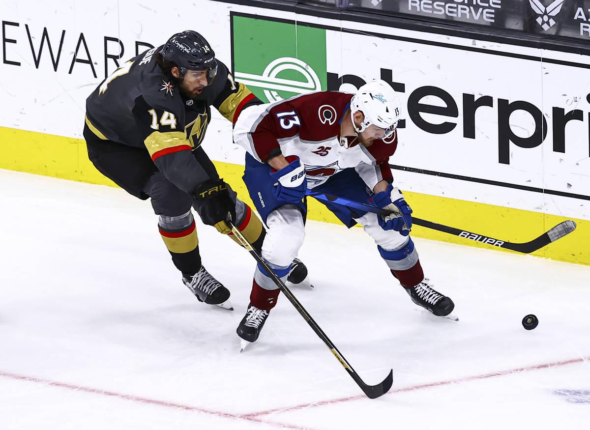 Colorado Avalanche's Valeri Nichushkin (13) skates with the puck under pressure from Golden Kni ...