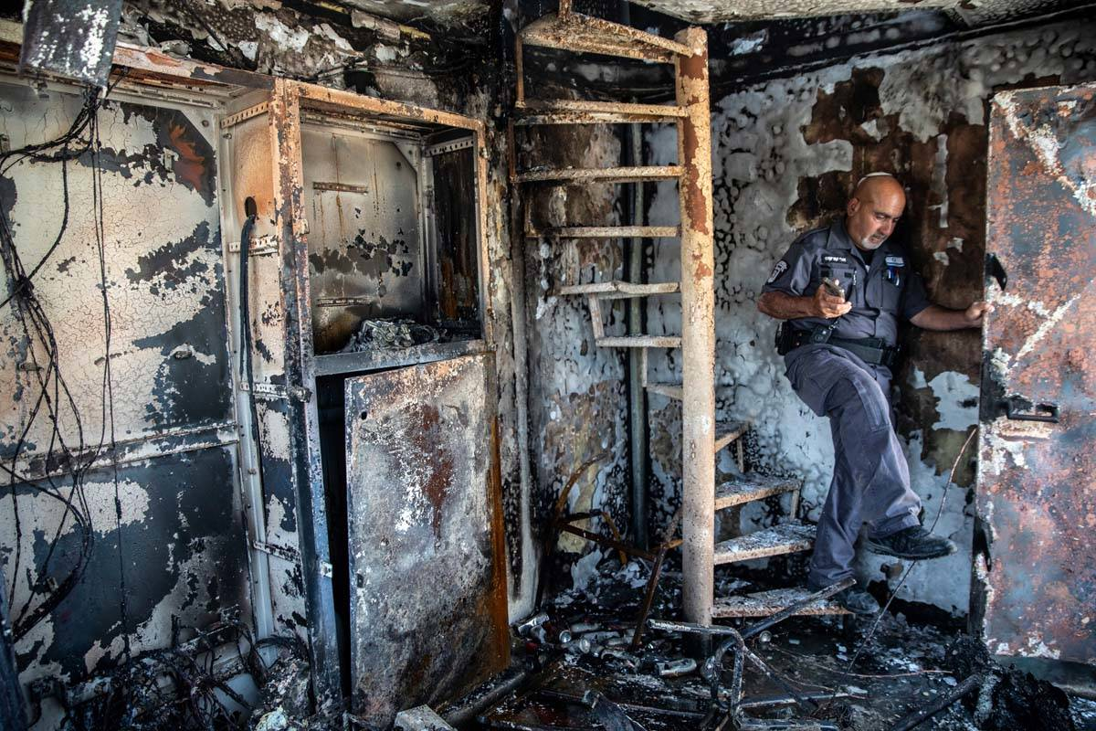 Avi Korkas, a municipality worker, examines the damages of a municipality office in charge of a ...