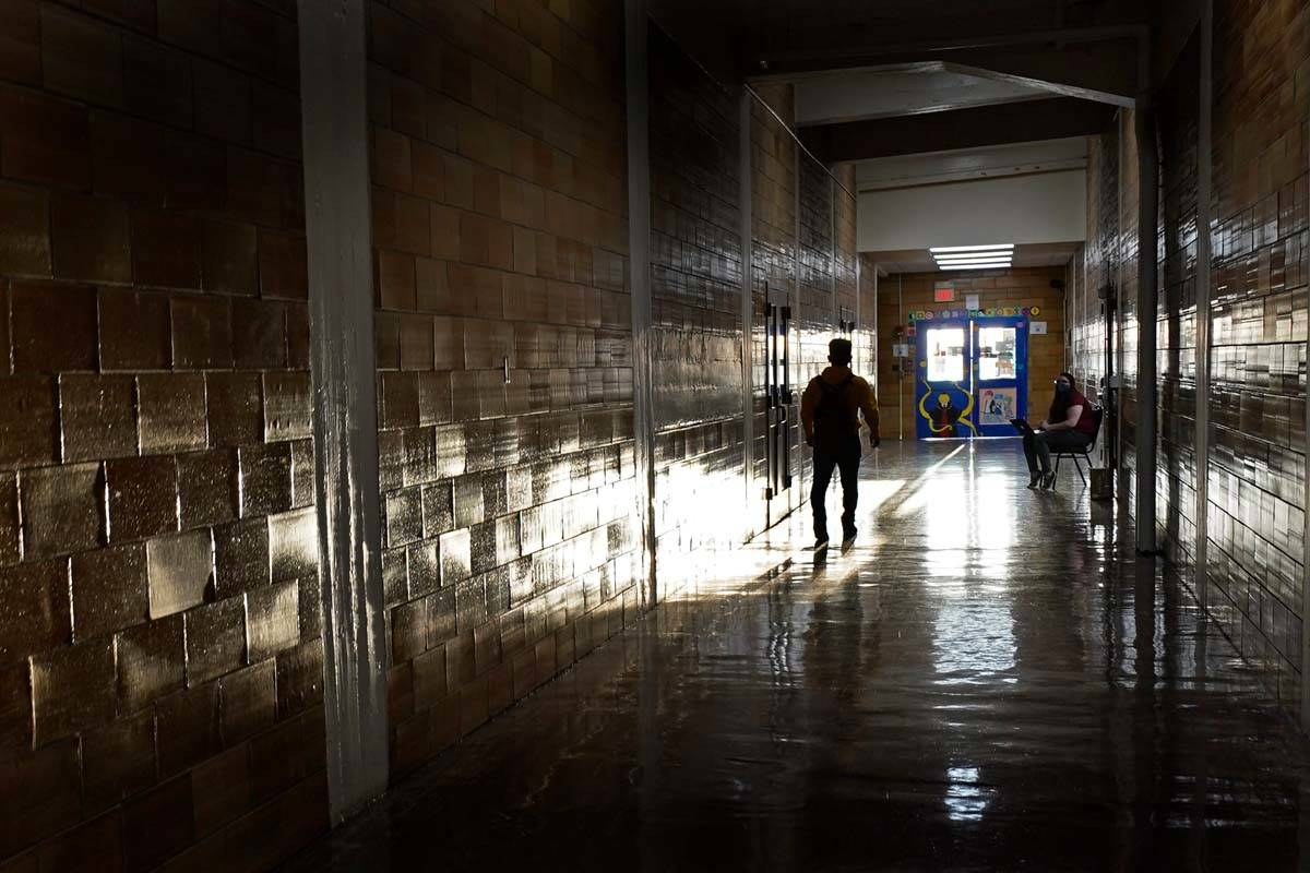 A student walks between classes at Wyandotte High School in Kansas City, Kan., on the first day ...