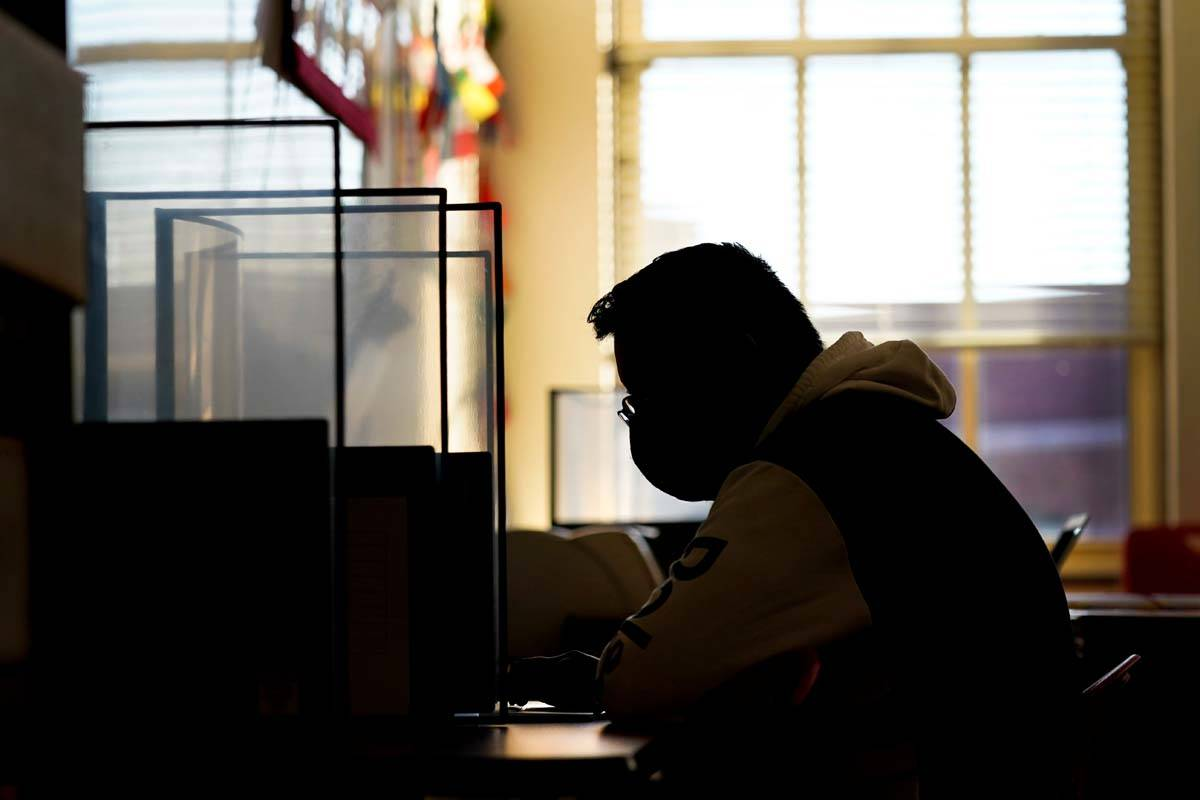 Senior Jose Solano-Hernandez takes a test on the first day of in-person learning at Wyandotte H ...
