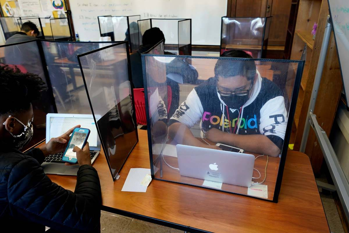 Senior Jose Solano-Hernandez, right, studies with classmates on the first day of in-person lear ...