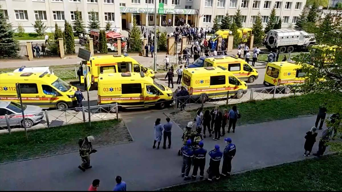 In this image taken from video, an ambulance and police trucks are parked at a school after a s ...