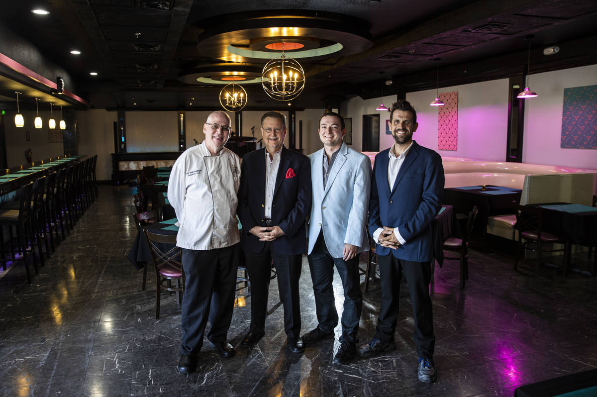 Chef David Robinson, owner of The Nevada Room, from left, poses with president Tom Michel, vice ...