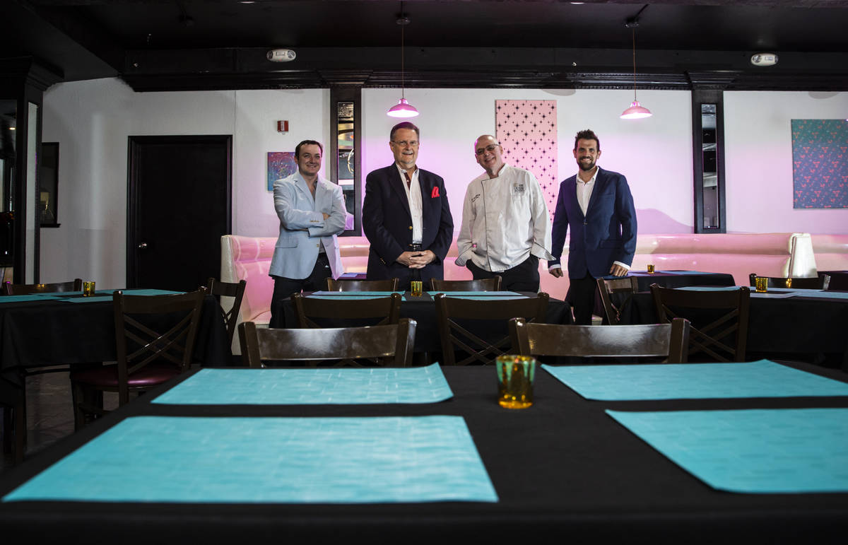 Chef David Robinson, owner of The Nevada Room, third from left, poses with, from left, vice pre ...