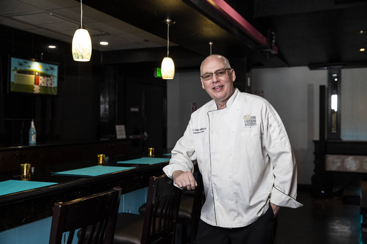 Chef David Robinson, owner of The Nevada Room, poses for a portrait at the venue at Commercial ...
