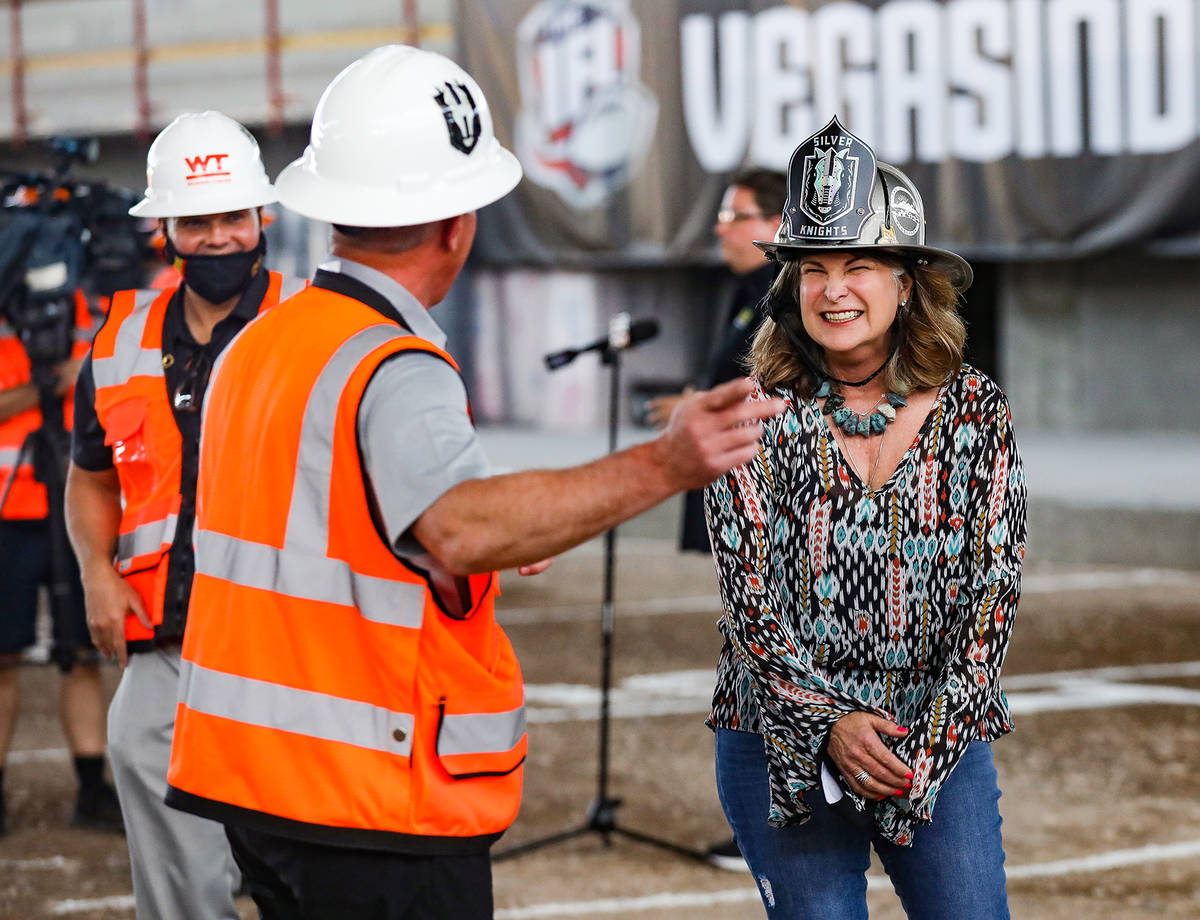 Henderson Mayor Debra March laughs with Kerry Bubolz, president of the Golden Knights, after at ...