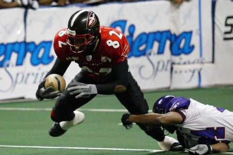 Sports-- Las Vegas Gladiators' Marcus Nash (82) stretches for extra yards after a pass receptio ...