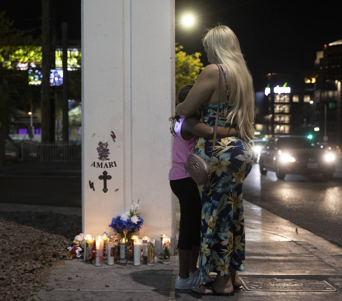 Rachelle Anthony, right, and daughter JaÕLea hug next to a memorial for Amari Nicholson ou ...