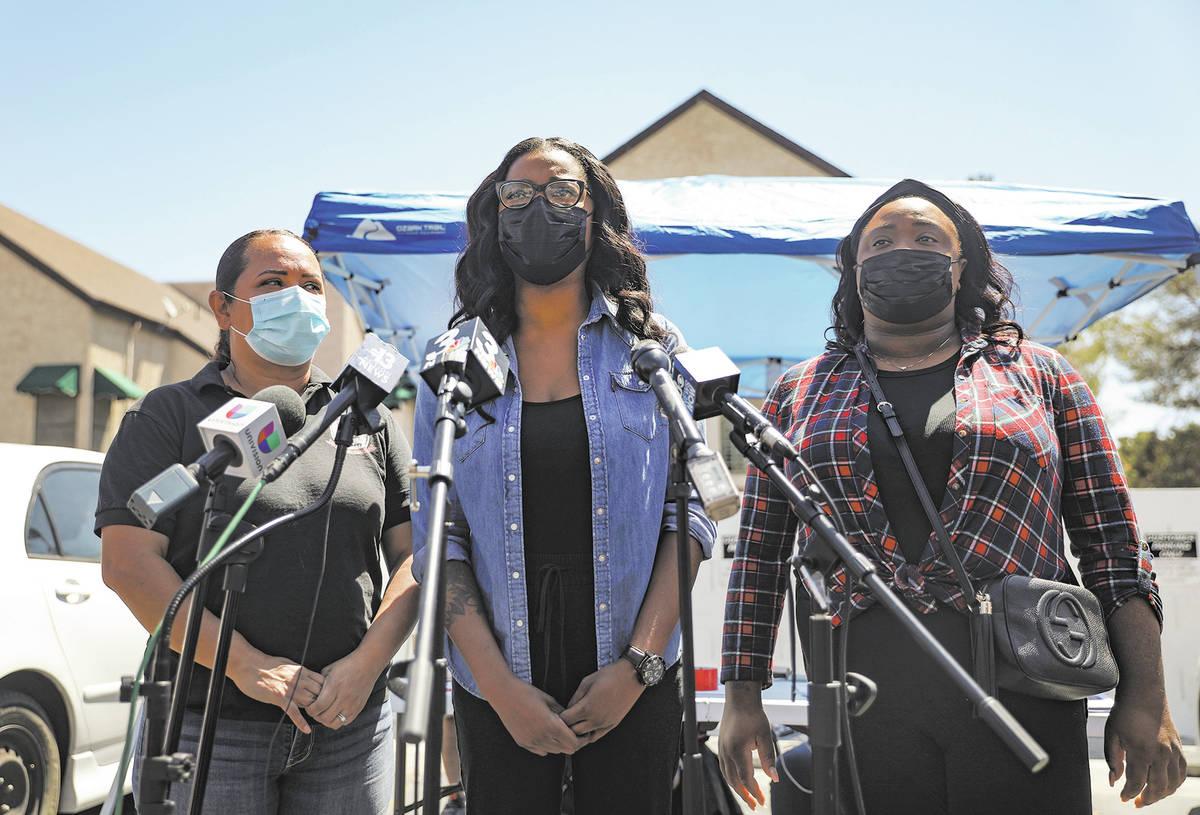 Yolanda Everett, aunt of 2-year-old Amari Nicholson who vanished last week, center, addresses t ...