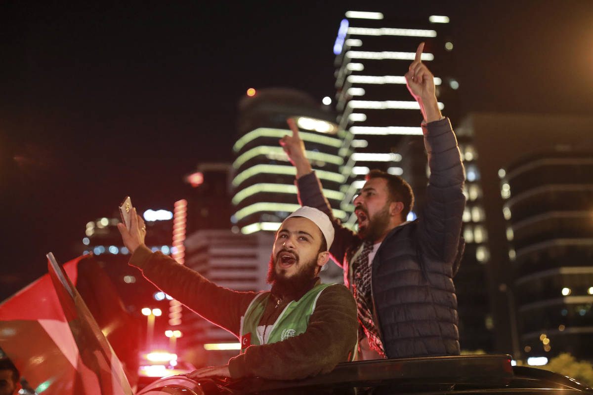 Protesters from IHH, a Turkish pro-Islamic organization chant anti-Israel slogans during a rall ...