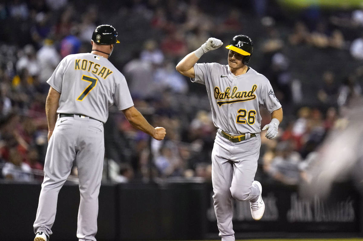 Oakland Athletics' Matt Chapman (26) celebrates his home run against the Arizona Diamondbacks w ...