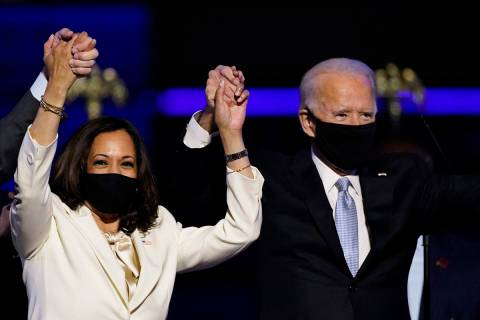 Kamala Harris holds hands with Joe Biden. (AP Photo/Andrew Harnik, File)
