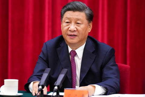 In this photo released by Xinhua News Agency, Chinese President Xi Jinping, speaks at a symposi ...