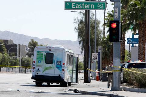Police investigate a crash involving a bus and a pedestrian Tuesday, May 4, 2021, at the inters ...