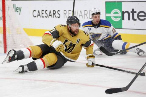 Vegas Golden Knights defenseman Alex Pietrangelo (7) and St. Louis Blues left wing Zach Sanford ...