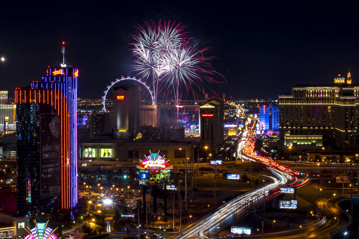 Fireworks explode over the Strip in Las Vegas as seen from ghostbar at the Palms hotel-casino o ...