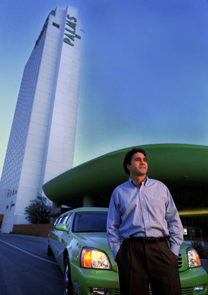 BUSINESS George Maloff stands in front of a lime green limo to be used to shuttle gamblers to t ...
