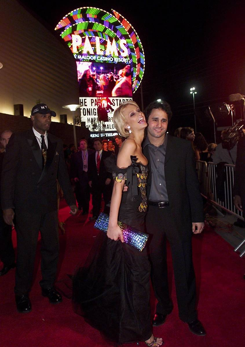 Palms President George Maloof poses with Paris Hilton during the grand opening of the Palms on ...