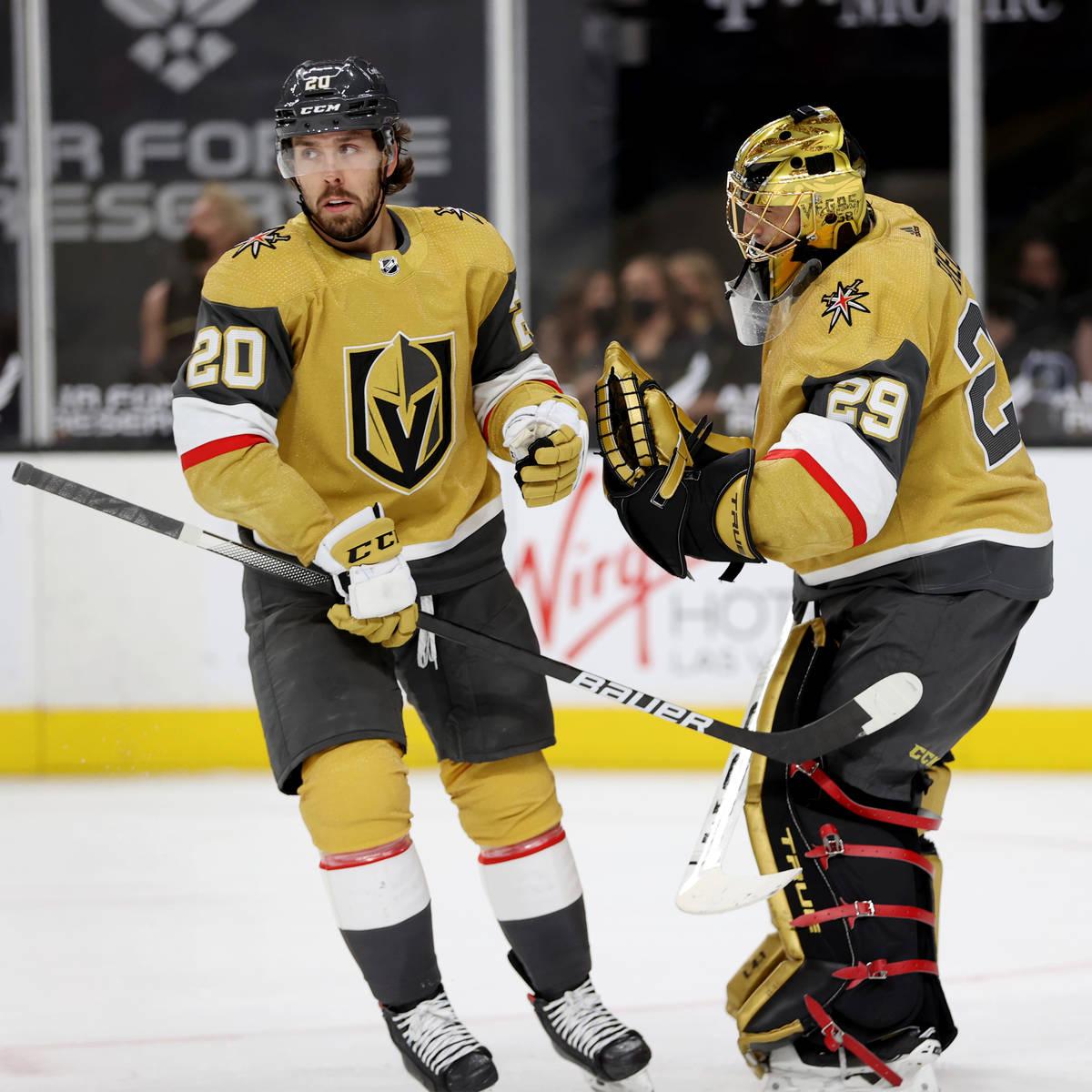 Vegas Golden Knights center Chandler Stephenson (20) celebrates his goal with goaltender Marc-A ...