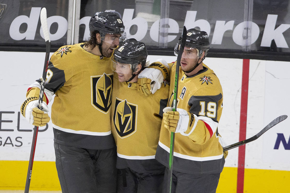 Golden Knights right wing Alex Tuch (89), left, center Jonathan Marchessault (81) and right win ...