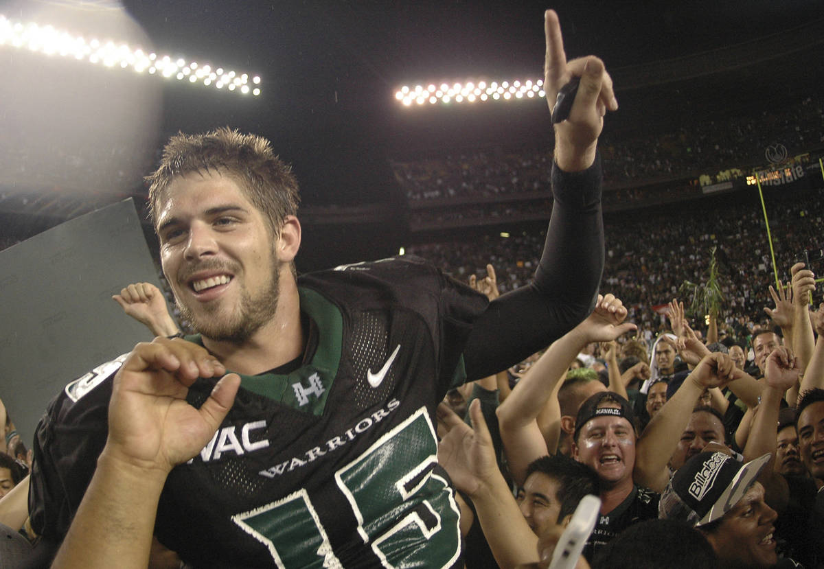 In this Nov. 23, 2007, file photo, then-Hawaii quarterback Colt Brennan celebrates after an NCA ...