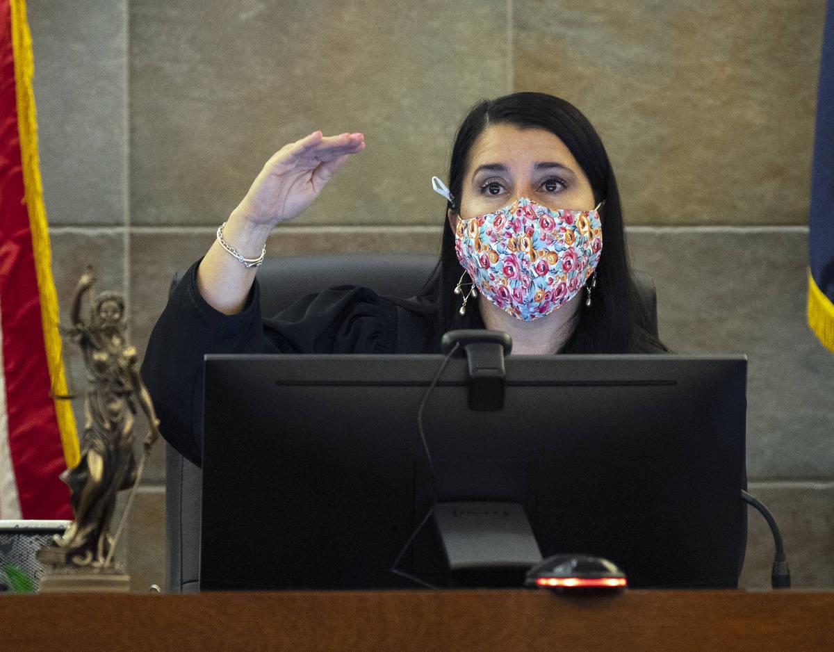District Judge Cristina Silva presides over Diego Salazar's plea hearing at the Regional Justic ...