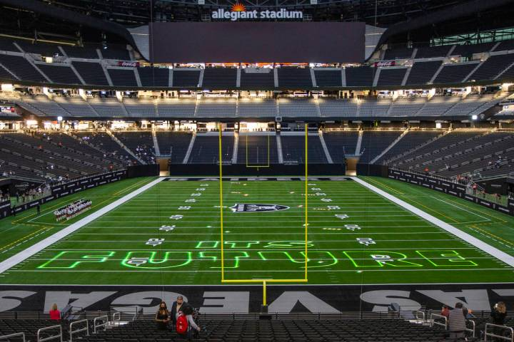 A short light show is projected onto the field during the 2021 Las Vegas Raiders NFL Draft Part ...