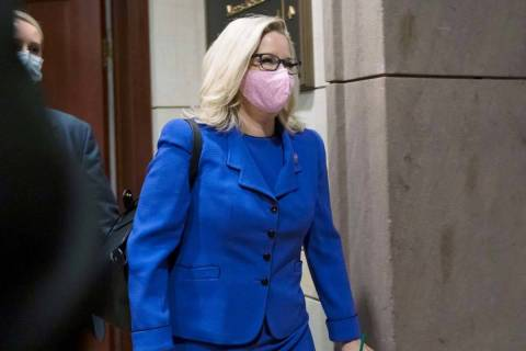 Rep. Liz Cheney, R-Wyo., arrives as House GOP members meet to decide whether she should be remo ...