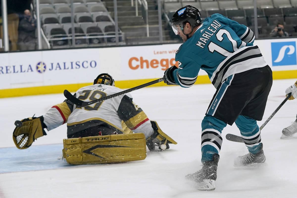 Vegas Golden Knights goaltender Marc-Andre Fleury, left, defends against a shot by San Jose Sha ...