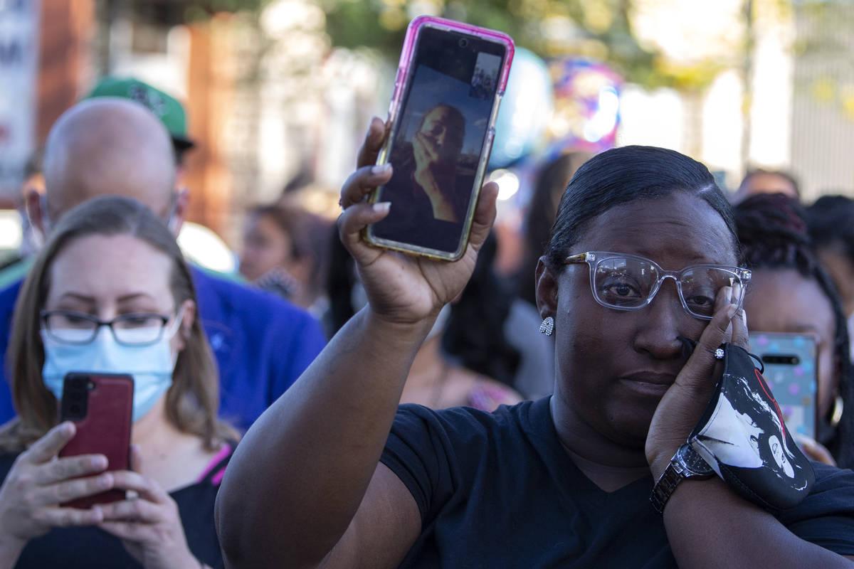 Arielle Mathews, a close friend of Amari Nicholson's grandmother, holds her on a video call dur ...