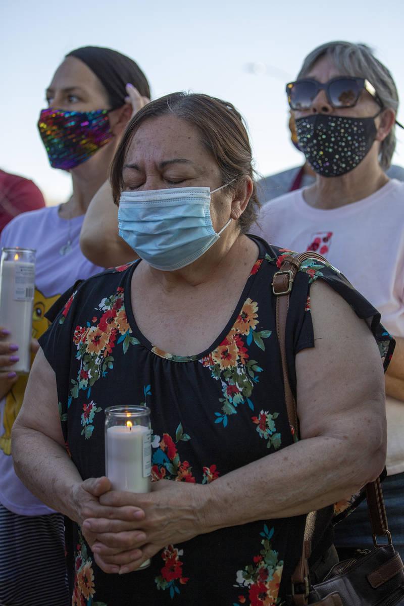 Maria Zapata prays during a vigil for 2-year-old Amari Nicholson, whose mother's boyfriend was ...