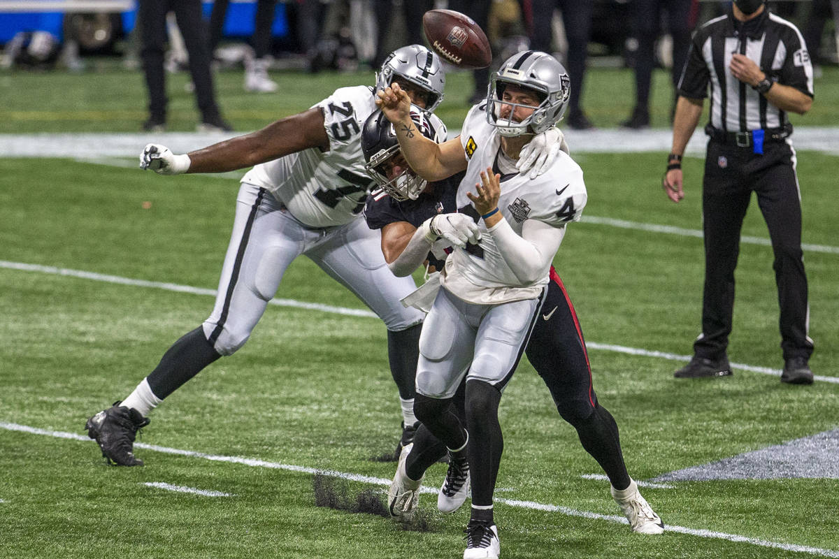 Atlanta Falcons defensive tackle Jacob Tuioti-Mariner (91) forces a fumble as Las Vegas Raiders ...
