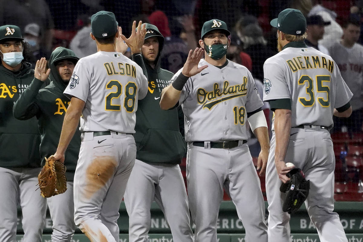 Oakland Athletics, including Mitch Moreland (18), congratulate each other after a 3-2 win over ...