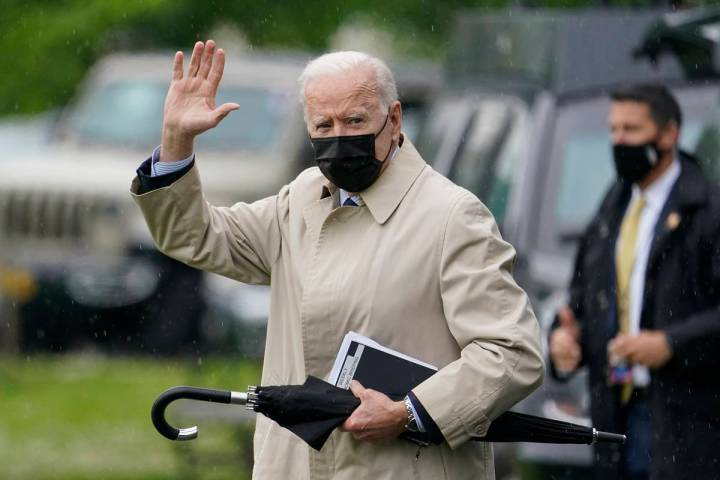 President Joe Biden waves as he walks to Marine One on the Ellipse near the White House, Friday ...