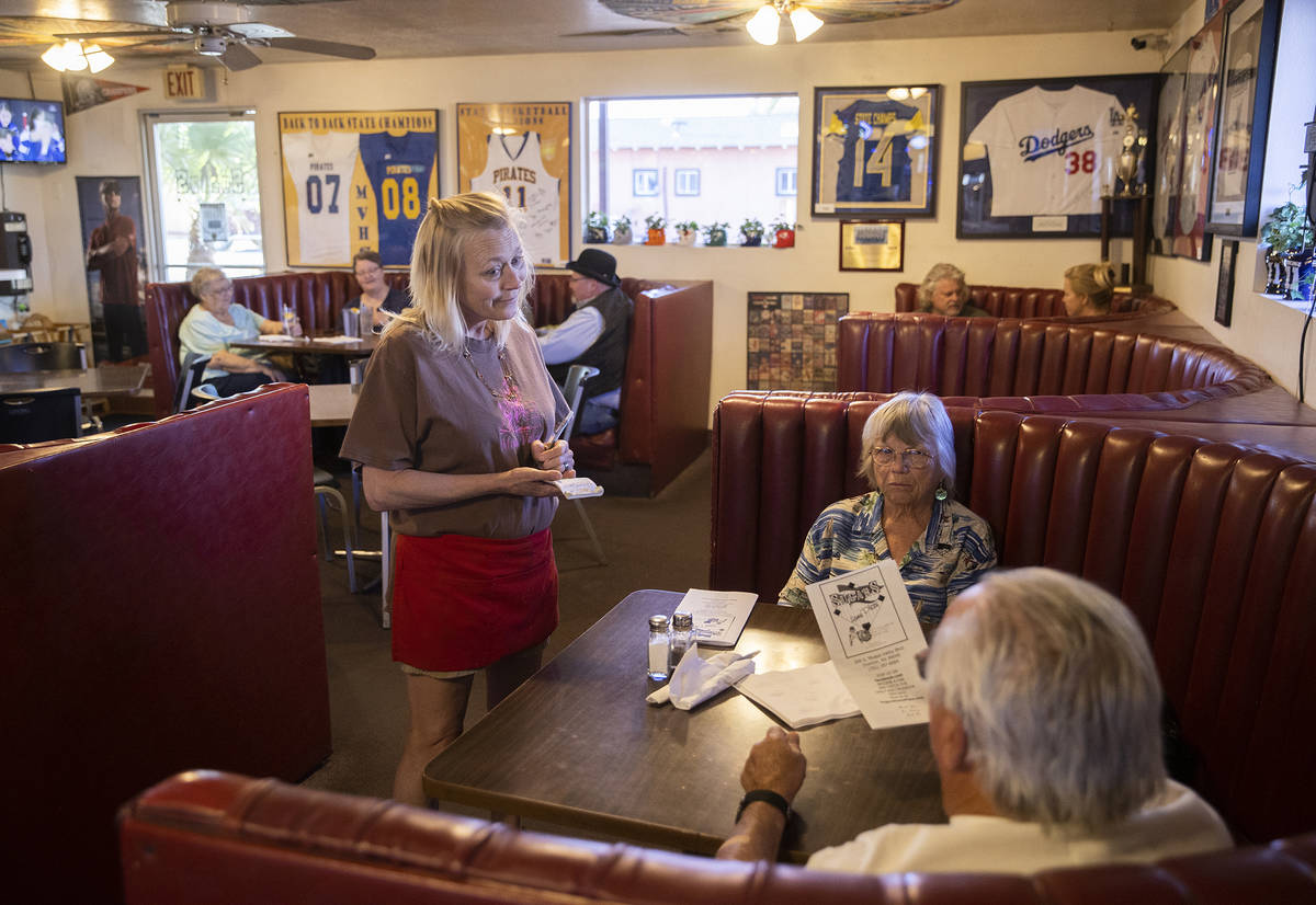 Waitress Kristin Perkins, left, takes a guests order during dinner at Sugar's Home Plate on Tue ...
