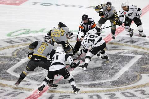 The puck drops to start the game between the Henderson Silver Knights and the Ontario Reign dur ...