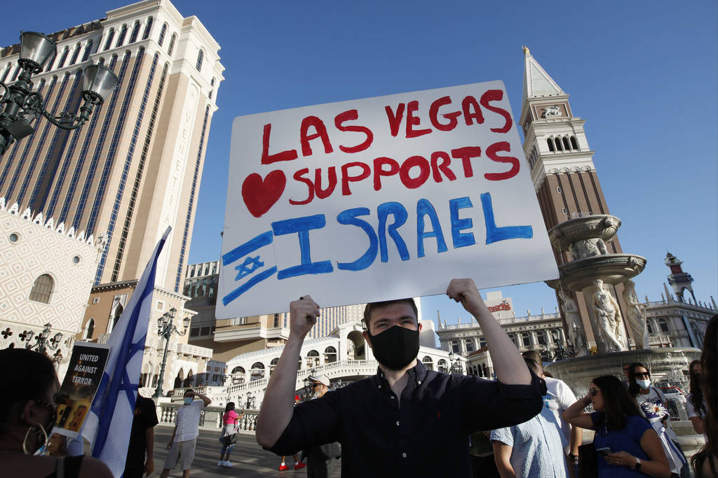 Michael Scheinman of Las Vegas holds a sign during a rally in support of Israel outside The Ven ...