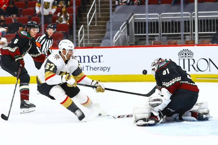 Arizona Coyotes goaltender Adin Hill (31) blocks a shot from Golden Knights' Max Pacioretty (67 ...