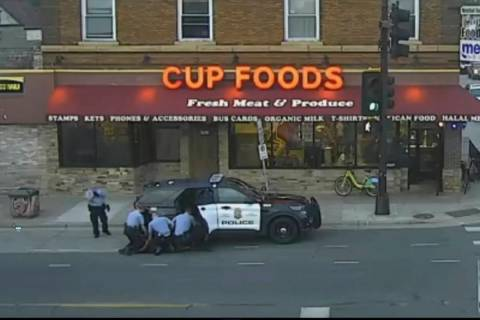 In this May 25, 2020 file image from surveillance video, Minneapolis police Officers from left, ...