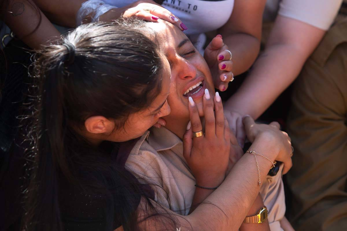 Friends and relatives of Israeli soldier Omer Tabib, 21, mourn during his funeral at the cemete ...