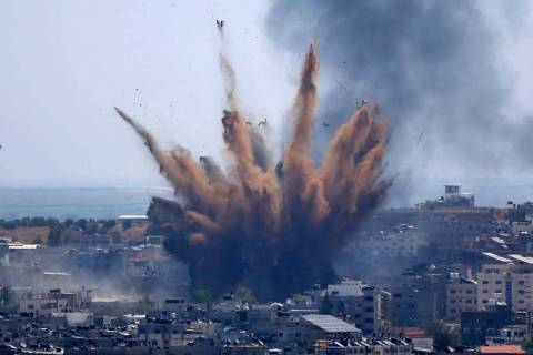 Smoke rises following Israeli airstrikes on a building in Gaza City, Thursday, May 13, 2021. We ...